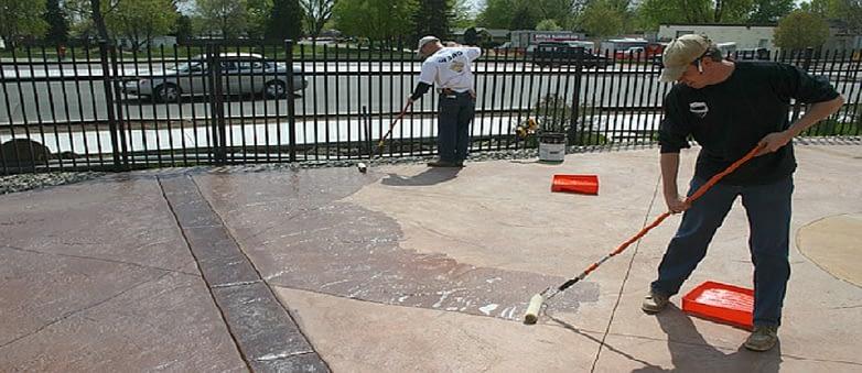 two guy doing concrete sealing