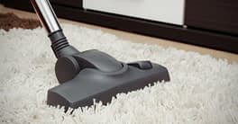 cleaning a vacuum carpet